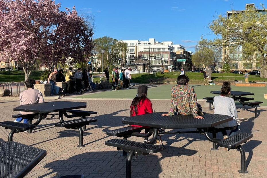 A nice spring day people activating space at Bde Maka Ska skate popup