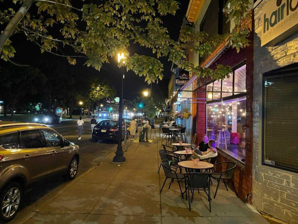 Outdoor dining on Hennepin at night at Kiku Bistro & Troubadour Wine Bar