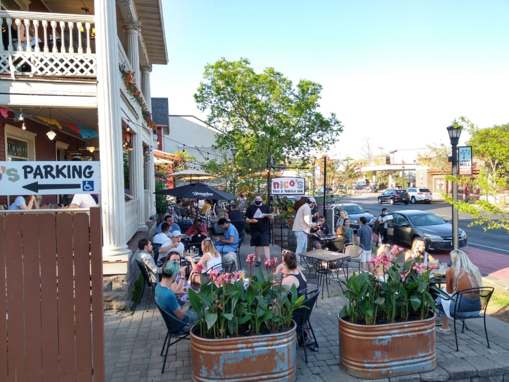 People dining outside at Nico's Taco on Hennepin Avenue