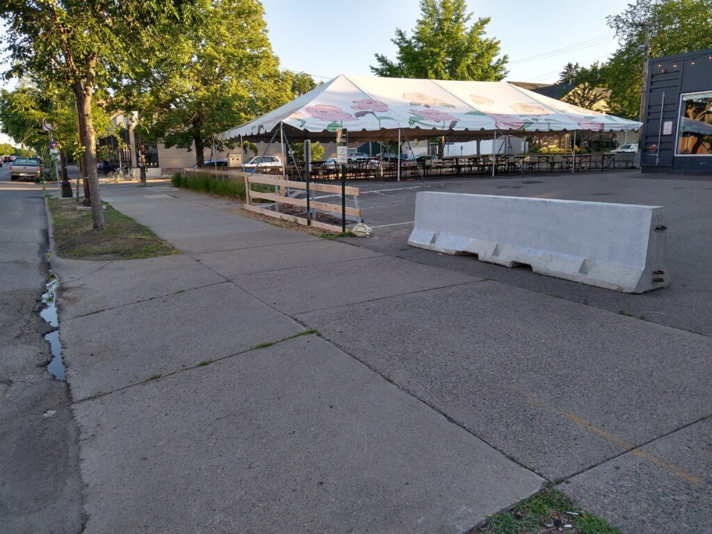 Lynhall sidewalk view of parking lot tent on Lyndale