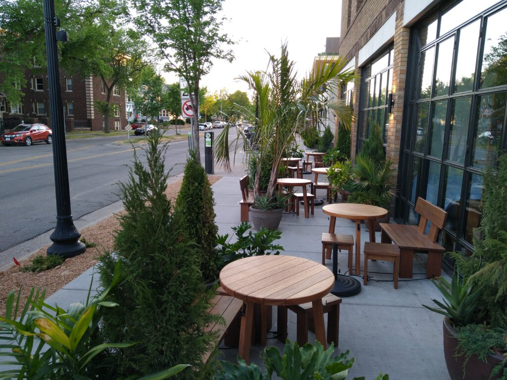 Outdoor dining space with plants and greenery at Sooki & Mimi