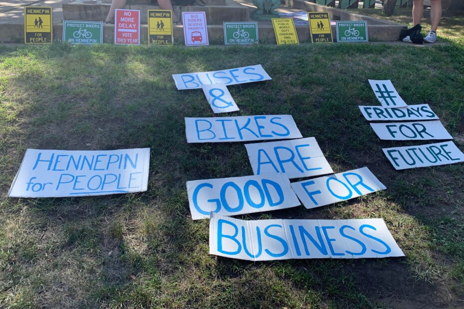 Signs: Hennepin for People, Buses and Bikes are good for business, #FridaysForFuture, Protect Bikers on Hennepin, No More Delay Vote This Year, Bus Riders Deserve Priority, Caution Public Works Department Ignoring Own Policies.
