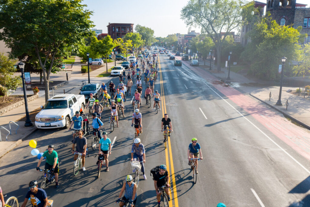 crowd shot of people participating in ride while biking on Hennepin Avenue.